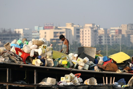 recycling with city in background