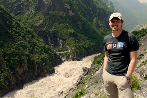 standing above the raging waters of the Yangtze River below